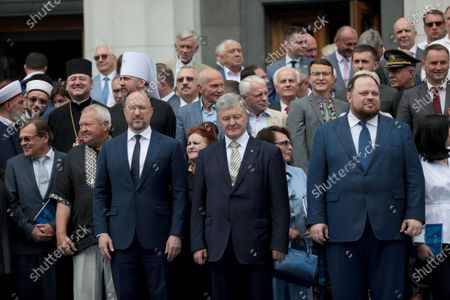Prime Minister of Ukraine Denys Shmyhal, former President of Ukraine Petro Poroshenko and First Deputy Speaker Ruslan Stefanchuk (L to R, middle) pose for a group photo outside the Ukrainian parliament building after the solemn meeting dedicated to the 25th anniversary of the adoption of the Constitution of Ukraine, Kyiv, capital of Ukraine.