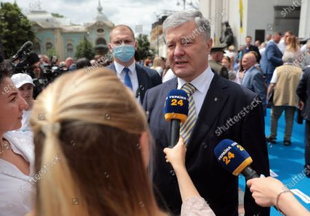 Stock Photo of Former President of Ukraine Petro Poroshenko speaks to the press outside the Ukrainian parliament building following the solemn meeting dedicated to the 25th anniversary of the adoption of the Constitution of Ukraine, Kyiv, capital of Ukraine.