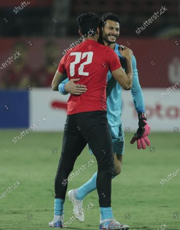 Ahly's Mohamed el Shenawy celebrate with ali lotfy during the second leg CAF champions league semi-final football match between Esperance and al-Ahly at the Alhly we Alsalam Stadium in on June 26, 2021.