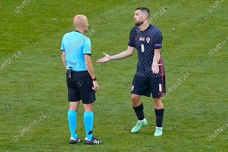 Mateo Kovacic of Croatia reacts to referee Cuneyt Cakir