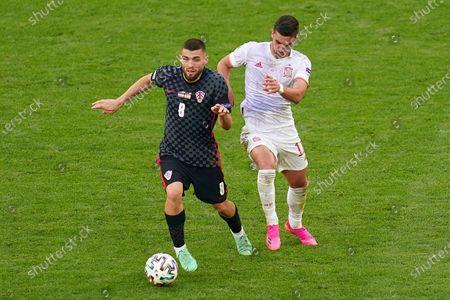 Mateo Kovacic of Croatia and Ferran Torres of Spain