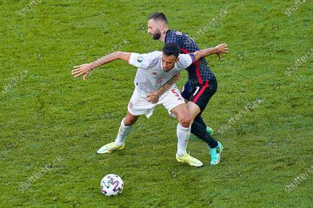 Sergio Busquets of Spain and Marcelo Brozovic of Croatia