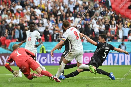 England's Harry Kane, centre, is tackled by Germany's Mats Hummels, right, during the Euro 2020 soccer championship round of 16 match between England and Germany at Wembley Stadium in England