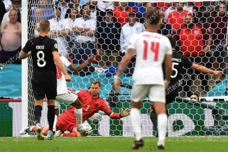 England's Raheem Sterling, 2nd left, celebrates after scoring his side's opening goal past Germany's goalkeeper Manuel Neuer during the Euro 2020 soccer championship round of 16 match between England and Germany at Wembley Stadium in England