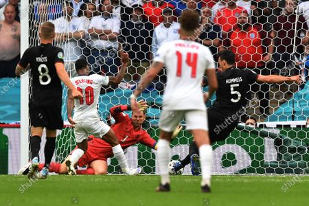 England's Raheem Sterling, 2nd left, scores the opening goal past Germany's goalkeeper Manuel Neuer during the Euro 2020 soccer championship round of 16 match between England and Germany at Wembley Stadium in England