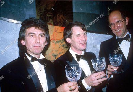 GEORGE HARRISON, MICHAEL PALIN AND DENIS O'BRIEN