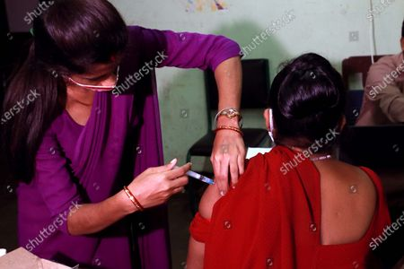 A health worker inoculates a sex worker  with the COVAXIN vaccine against the Covid-19 coronavirus during a vaccination drive in Kolkata, India, on June 29,2021.