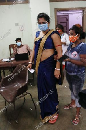 An Indian Sex workers  queue up to register and get inoculated with the Covid-19 coronavirus vaccine during a vaccination drive in Kolkata, India, on June 29,2021.