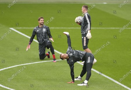 Goalkeeper Manuel Neuer (front) of Germany warms up prior to the UEFA EURO 2020 round of 16 soccer match between England and Germany in London, Britain, 29 June 2021.