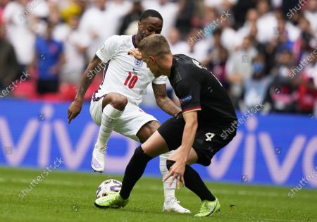 Raheem Sterling of England in action against Matthias Ginter (R) of Germany during the UEFA EURO 2020 round of 16 soccer match between England and Germany in London, Britain, 29 June 2021.