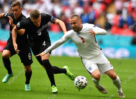 Luke Shaw (R) of England in action against German players Joshua Kimmich (L) and Matthias Ginter (C) during the UEFA EURO 2020 round of 16 soccer match between England and Germany in London, Britain, 29 June 2021.