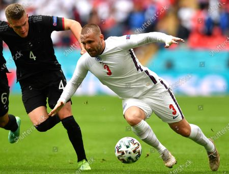 Luke Shaw (R) of England in action against  Matthias Ginter (L) of Germany during the UEFA EURO 2020 round of 16 soccer match between England and Germany in London, Britain, 29 June 2021.