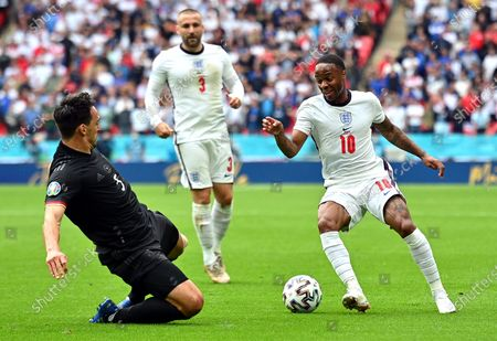 Raheem Sterling (R) of England in action against Mats Hummels (L) of Germany during the UEFA EURO 2020 round of 16 soccer match between England and Germany in London, Britain, 29 June 2021.