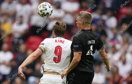 Harry Kane of England in action against Matthias Ginter (R) of Germany during the UEFA EURO 2020 round of 16 soccer match between England and Germany in London, Britain, 29 June 2021.