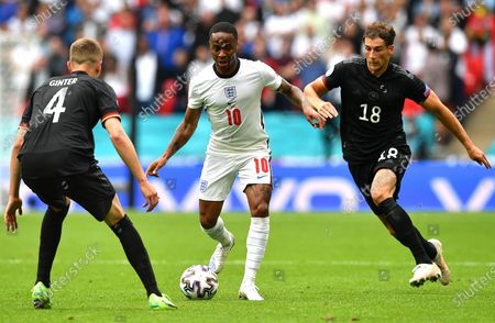 Raheem Sterling (C) of England in action against German players Matthias Ginter (L) and Leon Goretzka (R) during the UEFA EURO 2020 round of 16 soccer match between England and Germany in London, Britain, 29 June 2021.