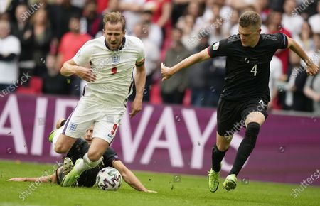 Harry Kane (L) of England in action against Matthias Ginter (R) and Leon Goretzka (down) of Germany during the UEFA EURO 2020 round of 16 soccer match between England and Germany in London, Britain, 29 June 2021.