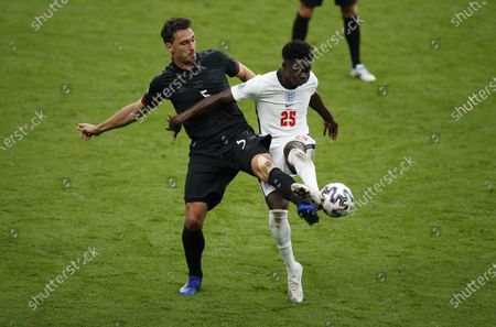 Mats Hummels (L) of Germany in action against Bukayo Saka of England during the UEFA EURO 2020 round of 16 soccer match between England and Germany in London, Britain, 29 June 2021.