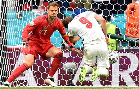Harry Kane (R) of England scores the 2-0 lead against Germany's goalkeeper Manuel Neuer (L) during the UEFA EURO 2020 round of 16 soccer match between England and Germany in London, Britain, 29 June 2021.