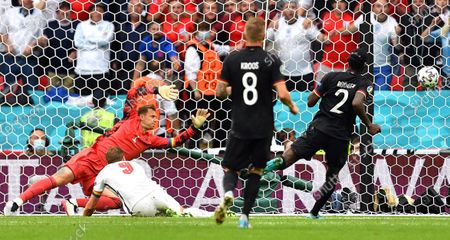 Harry Kane (2-L) of England scores the 2-0 lead against Germany's goalkeeper Manuel Neuer (L) during the UEFA EURO 2020 round of 16 soccer match between England and Germany in London, Britain, 29 June 2021.