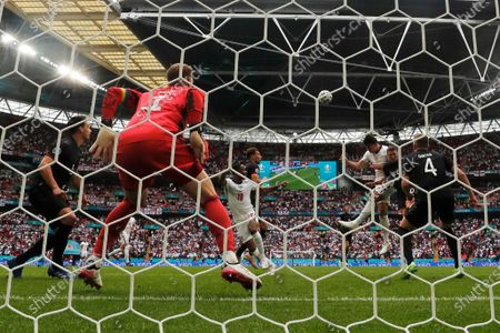 Germany's goalkeeper Manuel Neuer, foreground, watches as England's Harry Maguire, center left, heads the ball during the Euro 2020 Soccer Championship round of 16 match between England and Germany at Wembley Stadium in London