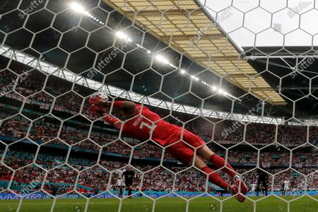 Stock Photo of Germany's goalkeeper Manuel Neuer leaps for a save during the Euro 2020 Soccer Championship round of 16 match between England and Germany at Wembley Stadium in London