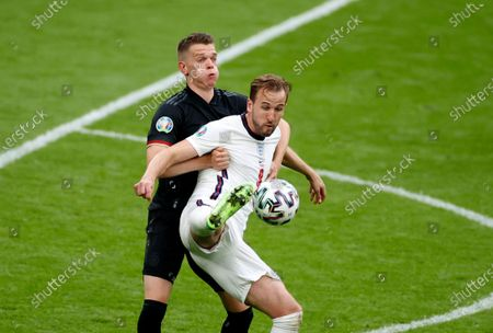 Stock Photo of England's Harry Kane, front, duels for the ball with Germany's Matthias Ginter during the Euro 2020 soccer match round of 16 between England and Germany at Wembley stadium in London