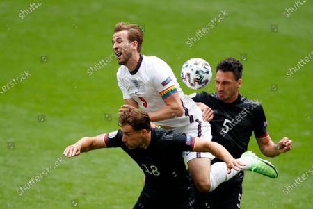 England's Harry Kane, center, duels for the ball with Germany's Leon Goretzka, left, and Germany's Mats Hummels during the Euro 2020 soccer match round of 16 between England and Germany at Wembley stadium in London