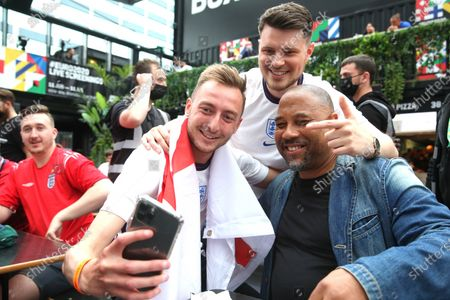 John Barnes in the fanzone.Fans watching the Euro 2020 game between England and Germany in the Boxpark in Croydon.
