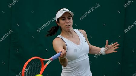 Christina McHale of the US returns the ball to Madison Brengle of the US during the women's singles match on day one of the Wimbledon Tennis Championships in London