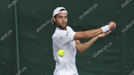 Stock Image of Portugal's Joao Sousa returns the ball to Italy's Andreas Seppi during the men's singles match on day one of the Wimbledon Tennis Championships in London