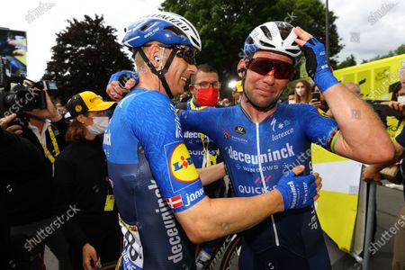 British rider Mark Cavendish of the Deceuninck Quick-Step team (R) hugs teammate Danish rider Michael Morkov of the Deceuninck Quick-Step team (L) in celebration after winning the 4th stage of the Tour de France 2021 over 150.4 kâ€m from Redon to Fougeres, France, 29 June 2021.