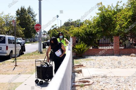 Editorial photo of Canvassing event for COVID-19 vaccinations, South l.a., Los Angeles, California, United States - 08 Jun 2021