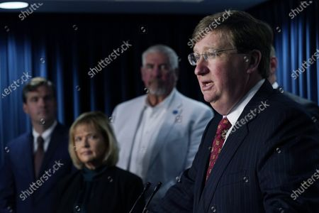 Republican Mississippi Gov. Tate Reeves, right, flanked by Ryan Miller, Executive Director of Accelerate MS, Rep. Becky Currie, R-Brookhaven, center, and Sen. Kevin Blackwell, R-Southaven, says during a news conference in Jackson, that lawmakers are working on a proposal to bring a medical marijuana program to the state, and plan to have a draft of the legislation ready later this summer