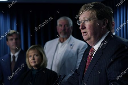 Stock Image of Republican Mississippi Gov. Tate Reeves, right, flanked by Ryan Miller, Executive Director of Accelerate MS, Rep. Becky Currie, R-Brookhaven, center, and Sen. Kevin Blackwell, R-Southaven, speaks of the business friendly Universal Recognition of Occupational Licenses Act which goes into effect on July 1, at a news conference, in Jackson, Miss. The legislation requires each of Mississippi's occupational licensing boards, agencies and commissions to issue licenses to applicants who hold a current license in good standing from another state, have been licensed by that state for at least one year, and satisfy certain other conditions
