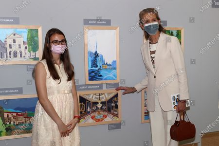 Spain's Infanta Elena (R) chairs the handover ceremony of the 30th edition of the 'Children and Youth Painting Contest for School Centers' of National Heritage at El Pardo Palace in Madrid, Spain, 29 June 2021.