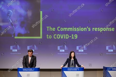 European Union Commissioner for Innovation, Research, Culture, Education and Youth Mariya Gabriel, right, speaks next to European Commission Vice President Margaritis Schinas during a news conference on the safe resumption of activities in the cultural and creative sectors at the European Commission headquarters in Brussels, . Cultural institutions in the European Union have lost up to four-fifths of revenue and attendance as the COVID-19 pandemic ravaged the continent and now need all the financial support they can get to restore their standing