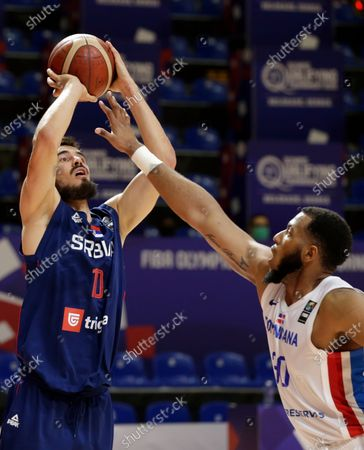 Serbia's Nikola Kalinic (L) in action against Dominican Republic's Jhonatan Araujo (R) during the Men's Olympic Qualifying Tournament game between Dominican Republic and Serbia in Belgrade, Serbia, 29 June 2021.