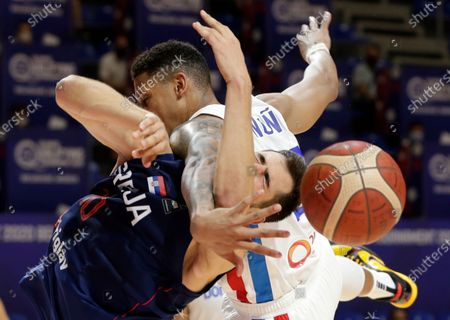 Serbia's Nikola Kalinic (L) in action against Dominican Republic's Angel Thomas Nunez Castillo (R) during the Men's Olympic Qualifying Tournament game between Dominican Republic and Serbia in Belgrade, Serbia, 29 June 2021.