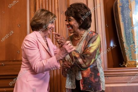 House Speaker Nancy Pelosi of Calif., left, and Rep. Maxine Waters, D-Calif., laugh after Waters told Pelosi a funny story, after Pelosi signed bill enrollments for Congressional Review Act Resolutions S. J. Res. 13, 14 and 15, on Capitol Hill in Washington