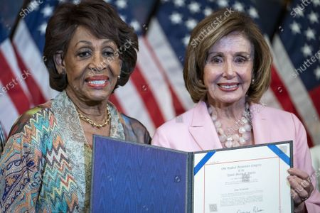 House Speaker Nancy Pelosi, D-CA, (R) and Rep. Maxine Waters, D-CA, participate in a bill enrollment photo opportunity for S.J. Res.13, S.J. Res.14 and S.J. Res.15, on Capitol Hill in Washington, DC, on Tuesday, June 29, 2021. The bills aim to reverse Trump era policies related to worker discrimination, methane emissions and the 'True Lender' rule.