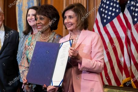 Speaker of the House Nancy Pelosi (R) holds a bill beside Democratic Representative from California Maxine Waters (L) during a bill enrollment ceremony for Congressional Review Act Resolutions, Senate Joint Resolutions 13, 14, and 15, on Capitol Hill in Washington, DC, USA, 29 June 2021. The Congressional Review Act reverses federal agency rules passed just before the end of the Trump administration.