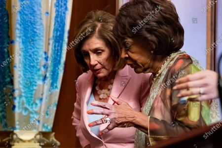 Speaker of the House Nancy Pelosi (L) speaks with Democratic Representative from California Maxine Waters (R) following a bill enrollment ceremony for Congressional Review Act Resolutions, Senate Joint Resolutions 13, 14, and 15, on Capitol Hill in Washington, DC, USA, 29 June 2021. The Congressional Review Act reverses federal agency rules passed just before the end of the Trump administration.