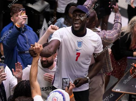 Rapper Stormzy celebrates England's 2-0 win over Germany in the EURO 2020 round of 16 game at Boxpark Croydon in south London.