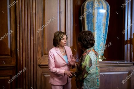 Speaker of the United States House of Representatives Nancy Pelosi (Democrat of California), left, talks with United States Representative Maxine Waters (Democrat of California) after signing three Congressional Review Act Resolutions, S. J. Res. 13, 14 and 15, at the US Capitol in Washington, DC,.