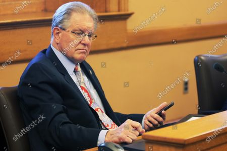 Stock Photo of Kansas state Sen. Mike Thompson, R-Shawnee, follows a discussion during a meeting of the committee that oversees the work of the Legislature's auditing division, at the Statehouse in Topeka, Kan. Thompson is skeptical of statistics on COVID-19 deaths in Kansas and wants an examination of how doctors and medical examiners conclude a death is caused by the novel coronavirus