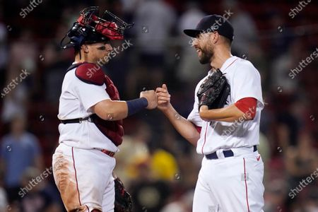Boston Red Sox relief pitcher Matt Barnes, right, is congratulated by Christian Vazquez after the Red Sox defeated the Kansas City Royals 7-6 in a baseball game at Fenway Park, in Boston