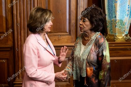 Stock Image of House Speaker Nancy Pelosi (D-CA) seen speaking with U.S. Representative Maxine Waters (D-CA) at a Bill Enrollment for three Congressional Review Act resolutions.