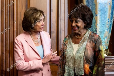 House Speaker Nancy Pelosi (D-CA) seen speaking with U.S. Representative Maxine Waters (D-CA) at a Bill Enrollment for three Congressional Review Act resolutions.