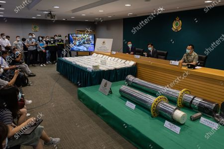 Divisional Commander (Airport Investigation) of Customs Drug Investigation Bureau, Lau Leung-chi, (L), the Head of Customs Drug Investigation Bureau, Lee Kam-wing, (C), and the Divisional Commander (Air Cargo) of Airport Command, CheungTin-ho, (R), attend a press conference showing seized bags of cocaine at the Customs Headquarters Building in Hong Kong, China, 30 June 2021. On 22 June 2021 Hong Kong Customs inspected an air cargo consignment arriving from Brazil at Hong Kong International Airport and seized about 110 kilograms of suspected cocaine inside two hydraulic devices with an estimated market value of about 130 million HK dollar, about 16.7 million US dollar.