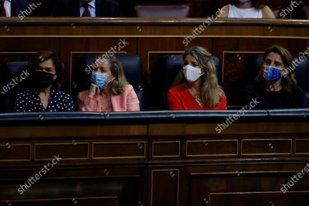 Spanish Deputy Prime Ministers (L-R) Carmen Calvo, Nadia Calvino, Yolanda Diaz and Teresa Ribera listen to the intervention of Spanish Prime Minister, Pedro Sanchez, in a plenary session held at the Lower House in Madrid, Spain, to explain the pardon to pro-independence imprisoned leaders as well as the results from the last European Council meetings, 30 June 2021.